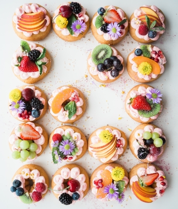 colorful cookies with fruit on top