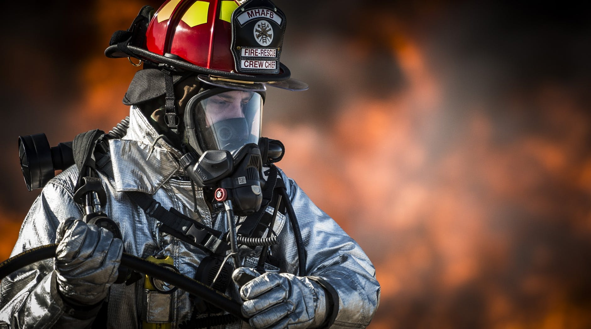 fire fighter wearing an oxygen mask and looking down